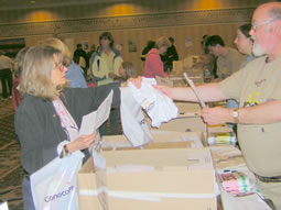 Volunteers hand out race packets during bib pick up.